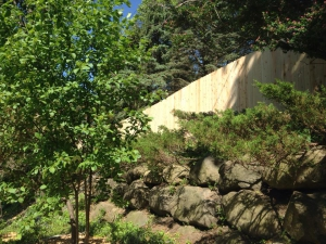 Uphill wood privacy fence